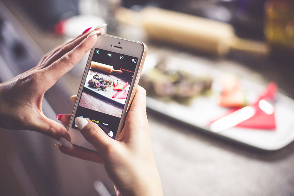 Girl Taking a Photo of Her Food
